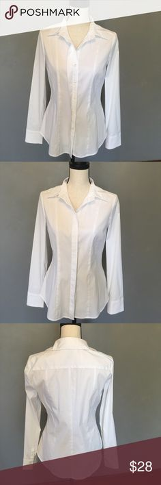 White House Black Market long sleeve Top size 10 WHBM long sleeve white top, size 10. 78% cotton, 19% nylon,3% spandex. Good condition. No trades. White House Black Market Tops Button Down Shirts