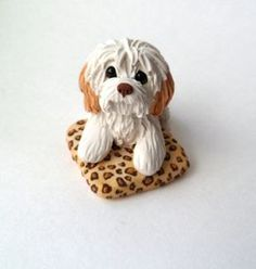 This cute pup is sitting up in its snazzy little leopard print bed   and waiting for a special somebody who will enjoy it. Hand sculpted from polymer clay this dog figurine is full of detailing like the leopard print  blanket which is not painted, its all tiny bits of clay!  Sure to please any dog lover!!  Measures approx. 2 inches tall , 2.25 inches wide  Thanks for looking!  get a custom version of this with your pup or kitty! Just convo me and ask! send pics and I will make that for you…