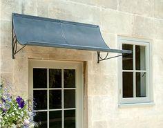 scoop-door-canopy-in-lead-effect-zinc