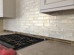 X Porcelain Tile With Glass Crackle Accent Strip At Kitchen - 3x8 tile backsplash