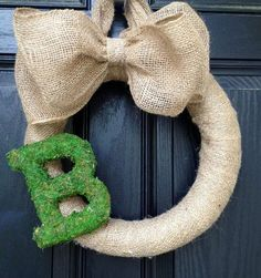 Burlap wreath with large bow and moss letter by KilbiBranchDesigns, $45.00