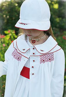 Stunning red and white smocked coat by Dandelion Avenue