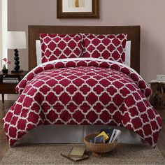 Refresh your master suite or guest room with this lovely comforter set, showcasing a quatrefoil motif in red for eye-catching appeal.  ...