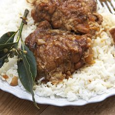 CHICKEN ADOBO from the PHILIPPINES: Chicken simmered with lots of garlic, vinegar and soy sauce until it's tender to the point of almost falling apart.