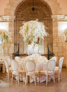 Glamorous Palm Beach Wedding, Tables with Tall Floral Centerpieces   Brides.com