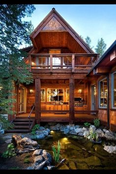 Amazing cabin style house and pond landscaping