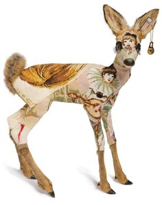 Take a taxidermy deer kid and cover it with old kitschy cross stitch work... Who has things like this at home? Who makes things like this? Who gets the idea of... Oh, deer...