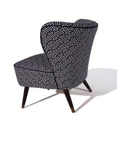Our elegant Bartolomew cocktail chair in Korla's Black Lattice with Black Bute trim. Shaken not stirred...
