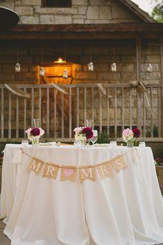 Sweetheart table with burlap banner | Photography: Closer To Love Photography - closertolovephotography.com  Read More: http://www.stylemepretty.com/california-weddings/2014/05/05/rustic-romantic-temecula-creek-wedding/