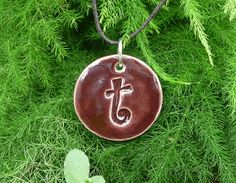 "Letter Pendant & Cord Necklace - Kiln-Fired Stoneware Clay - ""t"" - Chocolate Brown. $16.00, via Etsy."