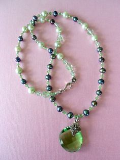 Swarovski Crystal Circle Pendant with Light Green and by mdeja, $90.00