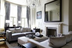 Interior Large Mirror With Black Wooden Frame Placed On The White Wall Above Fireplace Plus Gray Cream Sofa With Cushions Marvelous Large Decorative Wall Mirrors Offer Luxurious Look Of Your House