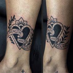 Tattoo Junnio Nunes coração faixa