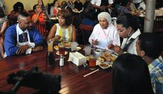 Oprah and her friend Gayle dining at Sweetie Pie's