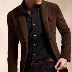Dark brown blazer on black shirt.
