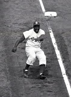 #UCLA // Jackie Robinson, the great disruptor, dances off of third in the 8th inning of Game 3 of the 1955 World Series.