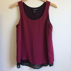 Forever 21 burgundy top Super pretty tank top.  Never worn.  Accepting overs!! Forever 21 Tops Tank Tops