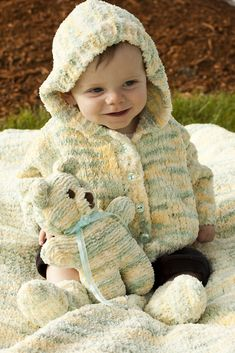 """Free Knitting pattern for Winter Warmer Baby Set with Sweater, Toy, Socks, and Blanket - Knitting pattern for hooded baby cardigan sweater with matching teddy bear, baby socks, and baby blanket. Sizes3-6 mo. 20"""", 6-12 mo. 24"""", 18mo. 26 ½"""". Designed bySusie Bonell for Cascade Yarns. Quick knit in bulky yarn."""
