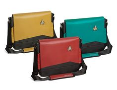 These Star Trek TNG Uniform Messenger Bags feature the red, blue, and gold division colors of ST:TNG along with a metal combadge affixed to the exterior. The interior features a sweet ST:TNG-themed lining and padding all around.