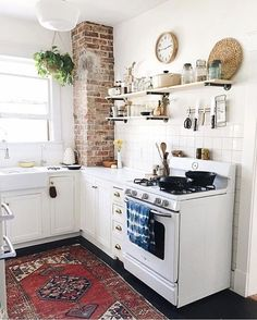 Cosy kitchen with exposed brick wall adding charm and character to this authentic kitchen.