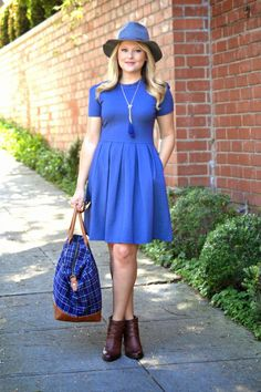 East vs. West Style: Jewel Tones - I am wearing a navy dress from Hutch Clothing, a plaid weekender bag from @Lulus, Wool Panama Hat and Brown Booties from @solesociety and gold tassel necklace is also from @Lulus.com. This is the perfect fall weekend outfit. #ootd (via @dmcheever)