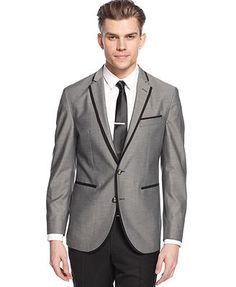 Grey suit with trousers and jacket with black contrast trim ...