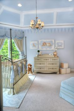 This nursery, designed by celebrity nursery designer Sherri Blum, features baby blue, creamy white & silver