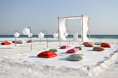 The Beach is always so romantic! What a chic touch for the guests to sit as they would on a normal day at the beach but with a lovely plush pillow! Beach Wedding, wedding on the beach.