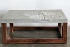 André Joyau's Lotus Leaf coffee table in highstrength cement and reclaimed hardwood by Heptagon Creations