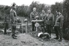 German Gebirgsjäger (mountain troopers) grieve for their comrade near Forsnat/Norway, June Note the grave with the paratrooper helmet. Pin by stinky old poop stain Army History, Germany Ww2, Lest We Forget, Paratrooper, World War Two, Troops, Wwii, Norway, Military