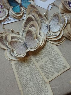 butterflies mounted on book pages