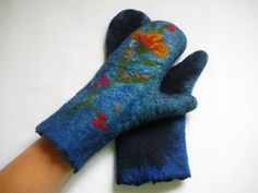 Blue felted mittens with yellow-red flower