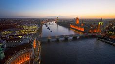 Aerial view of the River Thames, Houses of Parliament and Westminster Bridge at dusk. Copyright visitlondonimages/ britainonview/ Pawel Libera