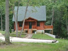 Beautiful log cabin built in a secluded wooded area. The cabin is fully furnished with a full kitchen, laundry room, 2 bedrooms with queen beds and satellite TV's, an open loft with 2 queen beds, private hot tub, ping pong table, and laundry room.  There is comfortable seating located upstairs and downstairs with satellite TV's and DVD players for entertainment.  You may use the gas grill, fire pit or the fully furnished kitchen for cooking.   Seating is available for 8 in the kitchen area…