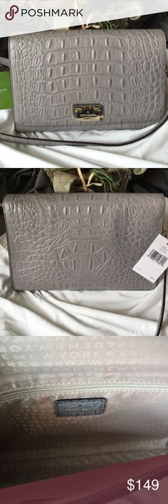 """NWT Kate Spade grey croc Fiona crossbody Perfect for Fall!  Cliff Grey Fiona crossbody from Kate Spade's Orchard Valley line.  Crocodile embossed cowhide leather with gold tone hardware. Interior has one zip pocket and two slide pockets. Measures 10&1/4"""" long X 2"""" wide X 7"""" deep. Strap is approx 22"""" drop - not adjustable. New with tags, unused, smoke & pet free home. Slight scratches on the front logo - see photo 4 the original plastic wrap is still part of the metal clasp. kate spade Bags…"""