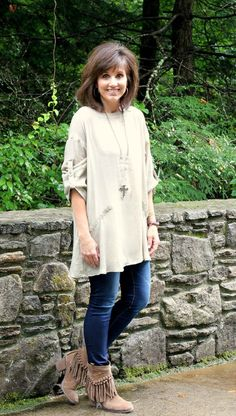 Love to style a tunic with fringe boots and skinny jeans for fall fashion.