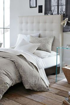 """I like this idea of DIY'ing a """"leather"""" headboard. I think it would look very chic"""