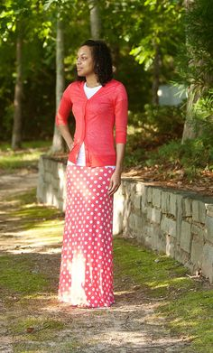 Solid flared polka dot skirt in coral worn with coral 3/4 sleeve cardigan