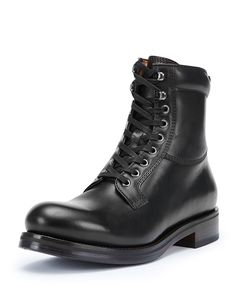 """Frye """"Carter"""" work boot in leather. Round toe. Lace-up front. Padded collar. Stacked heel. Rubber outsole. Made in Italy."""