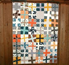 """Fabulous color combinations in this """"Happy Camper Wonky Cross Quilt"""" by Quilts by Emily."""