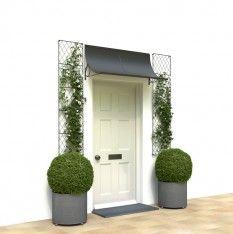Front door canopy over cottage door with side trellis and planters. 4-foot wide