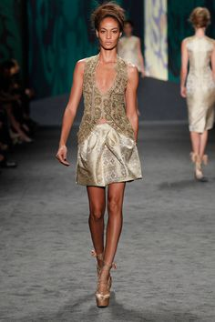 Gold embroidered lace cut away sleeveless jacket White Indian brocade tulip skirt | Photography: Dan Lecca
