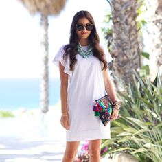 STYLE BLOGGERS - @RachParcell pairs a white dress with a bright...