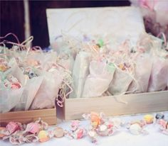 vintage inspired tea party use old jewerly boxes, suitcases as containers on the table with small bags from michaels filled for treat bags.......so cute check out this site, the mirrors on the fence incredible