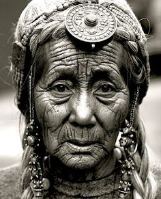 This picture tells lots of stories of her. This is actually a picture of a Tibet woman, she seems like she went through lots of thing in her life. The wrinkles are very deep on her face. Her eyes also tells tiredness. More