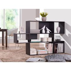 Shift Shelving Unit   dotandbo.com Idea for dividing reception/lobby area between place where visitors will sit vs. working space for employees along green wall
