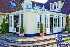 climbing the paved steps from garden to garden room, framed with sculpted topiary