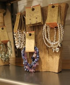 I like the contrast between the fine jewelry & the rustic display.  It would be better with old fashioned nails.