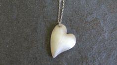 Hollow bead heart pendant with silk finish