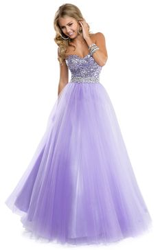 Flirt Prom Dress 2014 Style P5818 It's the classic Flirt love story. Girl meets tulle, sparkle, and sequins. Girl falls in love, wears Flirt, looks ultra-hot for her prom and lives happily ever after. Time to live you love story in this tulle ball gown with sparkling bodice. Available Colors: Lilac, Mermaid Green, Electric Pink